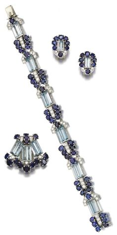 An Art Deco sapphire, aquamarine and diamond parure, Cartier, circa 1930. Comprising: a bracelet set with step-cut aquamarines, oval and circular-cut sapphires, circular- and single-cut diamonds, length approximately 175mm, signed Cartier, numbered