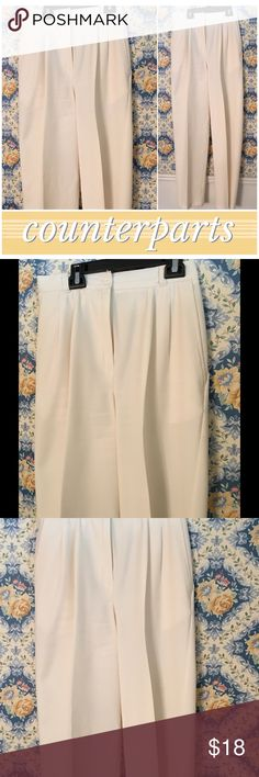 Counterparts cream slacks Year-round wardrobe piece. Add versatility to your closet with these slacks. When you have nothing to go with that top...Aha! I have those cream slacks! In great condition and have my two favorite features...HIGH & WIDE...high waist(which is, BY FAR, the best feature for a woman's figure) and wide leg. With these you get flattering and fashionable. Unlined but material is not thin. Like a twill. Also MACHINE WASHABLE! They wash great! Sz 14. counterparts Pants…