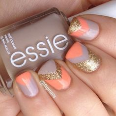 V-shaped glitter nail art design in gold glitter polish and melon and periwinkle polishes.
