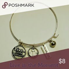 "Live in the Moment Bracelet Brand New - Never Worn   One Size Fits Most   A spiritual wire bracelet with 4 beautiful charms;  * Round pendant with the uplifting phrase ""Live in the Moment"" * Round anchor charm * Rectangle charm with the word ""Fearless"" * Dangling round ball  Great reminder for yourself or to give as a gift to a friend or loved one going thru a rough time in life.   Similar to Alex and Ani oneinamilliontreasures Jewelry Bracelets"