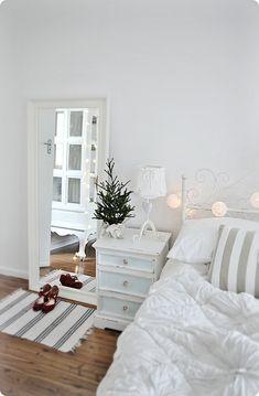 white coastal nautical Christmas bedroom with fairy lights more beachy ideas