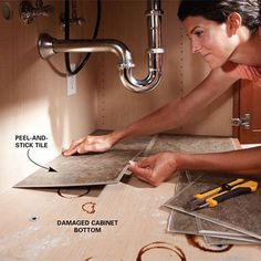 line your cabinet under the kitchen sink with peel and stick tile. Easy to wipe and helps cover already damaged cabinet bottom or helps to protect a new cabinet. Great idea!