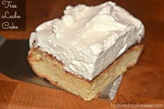 This Tres Leche cake topped with sweetened whipped cream is a perfect dessert your friends and family will love! Make this for Mardi Gras!