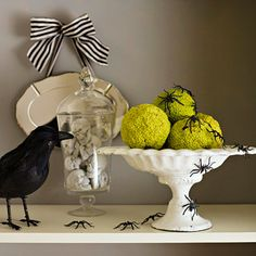 Place a few hedge apples on a small cake stand and a bunch of faux spiders all around. A crow could watch them dance!