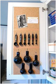 Cork board on the inside of a cabinet - or use 3M hooks. Keep grocery lists here. Good way to save space.