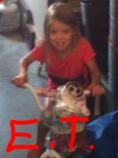 E.T. Is back as a monkey and and girl as the driver! ;D