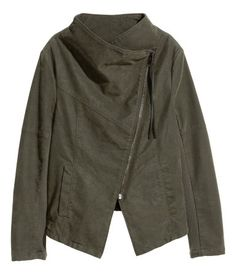 Khaki green. Biker jacket in imitation leather. Diagonal zip at front, ribbed jersey sections under arms, and side pockets. Lined.