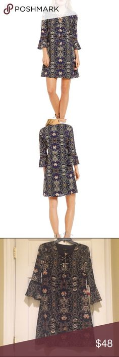 Jessica Simpson Printed Dress This beautiful shift dress from Jessica Simpson features: v- neckline, 3/4 bell sleeves, side seam zipper. Polyester/spandex. Size 2. New with tags. Length approx 34. Jessica Simpson Dresses Mini