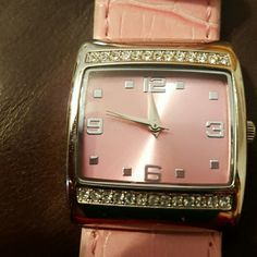 Pink Leather Watch Never worn except in picture. Pretty diamond like stones and Pink wrist strap.ticking right now!!!! Mary Kay Accessories Watches