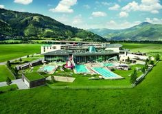 Tauern Spa Hotel & Therme Kaprun This 4-star superior hotel in Kaprun features 20,000 m² of indoor and outdoor spa area and a glass-covered outdoor pool. Each room has a balcony with impressive mountain views and a free minibar, which is refilled daily with non-alcoholic beverages.