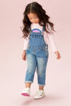 Let her have all the fun outdoors in this stylish mid blue dungarees. perfect for her holiday looks as well.