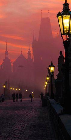 Morning fog at Charles Bridge in Prague, Czech Republic
