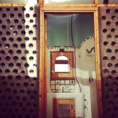 """365 Likes, 1 Comments - Earthship Biotecture (@earthship) on Instagram: """"Upstairs bathroom. Wine bottle walls.  #earthship #recycledmaterials"""""""