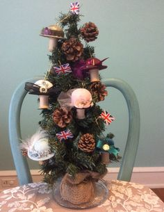 Beautiful christmas tree! Perfect for a Downton Abbey themed christmas party. English flags and mini hat ornaments. Great gift idea too!
