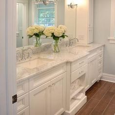 white built-in vanity, marble countertop, staggered porcelain wood effect tile