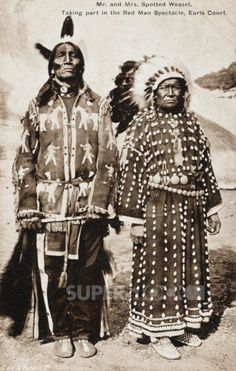 Mr and Mrs Spotted Weasel - Sioux Indians taking part in the Red Man Spectacle at Earls Court, London     Date: 1909