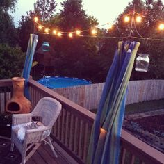 Just put up some outdoor curtains, cafe lights and hanging candle jars on our deck.