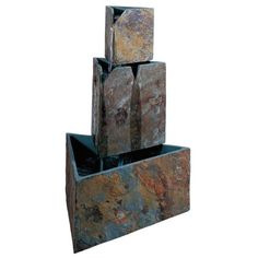 An insightful blend of old and new, the Stacked Triangles Outdoor Fountain pairs a modern geometric design with the rustic patina of weathered slate. Perfect for your backyard, deck, or sun room, this fountain doesn need any plumbing or hard-wiring plug it in, then enjoy the serene sound of cascading water.              Triangles are cut from natural slate        Polished river stones included        UL-listed recirculating water pump is approved for outdoor use       6