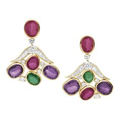 The earrings are finished in 18K gold, with 9.36ct red tourmaline, 3.03ct emerald, 12.58ct amethyst, 3.13ct brilliant-cut diamonds and 3.47ct baguette-cut diamonds. The pair of earrings of MVSA serie are launched from Bulgari in 2014. Inspired by the cobblestone from Mediterranean coast, the earrings are held with emerald, amethyst and pink tourmaline in bezel settings.