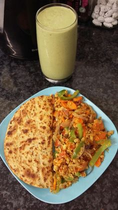 Breakfast: scrambled eggs & veggies, 1 methi roti, & green smoothie. >>Eggs: Sauté onions in 1/2 tsp oil and let it cook. Then add minced garlic and let this cook too. Follow with chilli flakes. I then added diced tomatoes and let it soften with the onion garlic sauté. Next, add carrots & green peppers, squeeze of lemon juice. Finally add 2 beaten eggs and cook it well through. >>Smoothie: Blend raw spinach (about a medium bowl size),1 frozen banana (it will be much thick & tasty if it's…