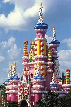 29 Things You'll Never See At Disney World Again: For the 25th anniversary of Magic Kingdom in 1996, Cinderella's Castle was transformed into a giant birthday cake. It took over 400 gallons of pink paint to transform the 18-story structure, which included 20-foot candles, 5-foot gummy bears, 5-foot gumdrops, 6-foot Life Savers, 3-foot lollipops, and 2-foot gum balls. The icing was inflatable, and it covered more than 1,000 feet until 1998, when the castle was restored to normal.