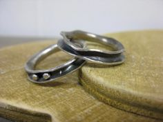 Sterling silver anticlastic rings by Bay Design