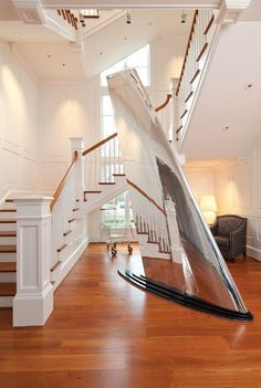 Aberdeen Creek: Elegant foyer staircase featuring airplane wing sculpture from MotoArt. Designed by Purple Cherry Architects.