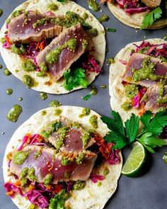 Marinated Ahi Tuna Tacos W Asian Slaw and Cilantro Pistachio Pesto Give It Some Thyme - Putting Yourself In An Overstuffed Taco Situation Is Inevitable With Tender, Citrusy Tuna Nestled On Crunchy Asian Slaw And Drizzled With Cilantro Pistachio Pesto Ahi Tuna Recipe, Tuna Steak Recipes, Fish Recipes, Seafood Recipes, Mexican Food Recipes, Dinner Recipes, Cooking Recipes, Healthy Recipes, Fresh Tuna Recipes