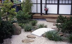 Japanese Courtyard Garden With Concrete Bridge And Stepping Stones ...