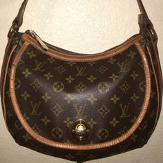 "Louis Vuitton Tulum PM Authentic LV Tulum PM Monogram Canvas Leather Hobo Shoulder Bag. 11.8 by 9.1"". Belted leather strap with front flap pocket with turnlock. A few cracks as shown but still in good condition. Originally $1340 Louis Vuitton Bags Hobos"