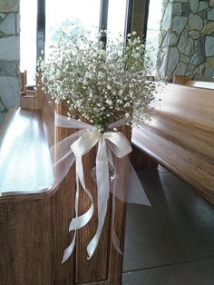 DIY aisle decor -So pretty.. baby's breath tied with ribbon. Source: dahliaonline via flickr #DIY #aisledecor #babysbreath