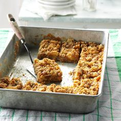 Caramel Apple Bars Recipe -These bars make a great fall dessert. We like to warm individual servings in the microwave and serve with a scoop of vanilla ice cream. It quickly became a family favorite. Maybe it'll become one of your family's, too. —Carol Stuber, Osawatomie, Kansas
