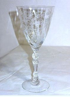 These are Elegant Glass water goblets in the Chintz pattern that were made by Fostoria. They stand 7 and 5 eighths inches tall and hold 9 oz. These goblets are in very nice condition with no chips or