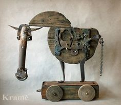 Trojan horse, wood and gears.  l love his long head and wheels