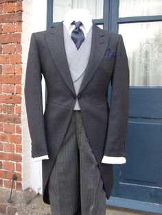 Men's formal daytime attire, known as a morning suit.