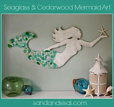 How beautifully created is this mermaid that's accented with sea glass.