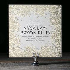 The popular Joie de Vivre letterpress wedding invitation suite by Kamal for Bella Figura features festive dots reminscent of champagne or confetti.