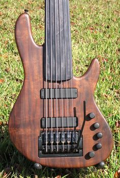 Beautiful six string fretless bass with a Kahler bass tremolo