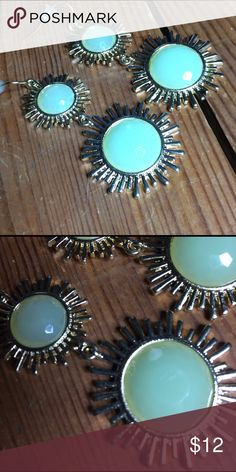 The 'Sunburst' Dandre Statement Earrings The 'Sunburst' Goldtone and Faux jade statement dangle earrings are the perfect Boho summer accessory!!! Beautiful gold tone sun style details with faux jade stones. Color ME Crazy Boutique Jewelry Earrings