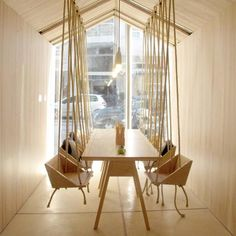 This cafe features wooden swing seats for both adults and children: http://www.dezeen.com/2015/02/20/fiii-fun-house-cafe-buenos-aires-iris-cantante-wooden-swing-seats/ … #interiordesign