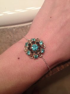Bracelet made from antique clip-on earring on a very dainty chain!