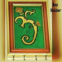 TITLE :Om and Ganesha. MEDIUM : Acrylic and Ink on Wood. THEME : Ganesha formed out of an Om. #MeghnaCreations #creations #keyholder #om #ganesha #artwork #acrylicpainting #inks #on #wood #brownandgold #frame #goldembossed #motifs #silverhooks #foryourkeys #cute #elephantgod #favourite #gift #gifting #mumbai #pintrest