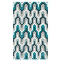 Hand-tufted rug with geometric motif.   Product: RugConstruction Material: 100% PolyesterColor: Ice blue, silvered gray, and teal blueFeatures: Hand-tuftedNote: Please be aware that actual colors may vary from those shown on your screen. Accent rugs may also not show the entire pattern that the corresponding area rugs have.Cleaning and Care: Blot stains