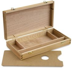 """Protect and organize pens, pencils, charcoal, blending tools, inks, small accessories and more. This hand sanded box is constructed of elm hardwood and features durable finger-joint construction. It is finished with sturdy brass latches and hinges. The sketch box measures 12-1/2"""" x 6-1/2"""" x 2-1/8"""""""