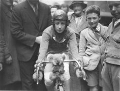 Close-up of Billie Samuels on the Malvern Star bike showing her koala bear mascot before leaving for Melbourne, 4 July 1934, by Sam Hood    (via Stunning Vintage Photos of Australian Bike Culture in the Early 1900s | Brain Pickings)    Amazing!