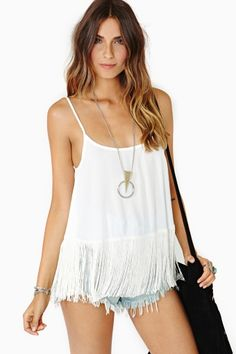 White fringed singlet, denim cut offs, sterling pendant and black suede cross body. Bohemian chic threads.