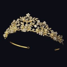 You will dazzle in this royal flowered tiara. Faux pearls and Swarovski crystals sparkle among the rhinestone encrusted pattern, a perfect accessory for the modern or classic bride. The ornamented por