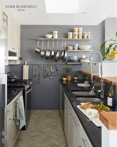 A one-bedroom penthouse apartment in a historical Brooklyn Heights Brownstone becomes a traveler's layered dream home for the interior designer, her husband and their Australian Shepherd. #kitchenrenovation #modernkitchen Modern Kitchen Cabinets, Kitchen Items, Kitchen Interior, Kitchen Decor, Kitchen Design, Kitchen Colors, Kitchen Sink, Kitchen Appliances, Home Design