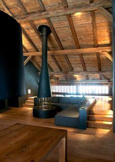 luxury wooden livingroom with a fireplace / Jérémie Koempgen