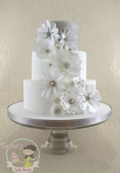 Wafer Paper Flowers Wedding Cake - A new display cake for this season, featuring delicate shimmering wafer paper flowers in the style of fabric 3D flowers from bridal gowns